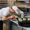 032816   Wesley Bunnell | Staff<br /> <br /> Grand Pizza & Restaurant has opened for business. Benny Qoku prepares broccoli rolls.