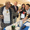 11/21/17  Wesley Bunnell   Staff<br /> <br /> A conference was held Tuesday morning at New Britain City Hall between the city and The United Way announcing a program where city employees can elect to have a portion of their paycheck automatically donated to The United Way.  Executive Director of OIC New New Britain Paulette Fox swipes her card at the dip jar machine to make a donation with the help of United Way Partnership Manager Mona Brewster.