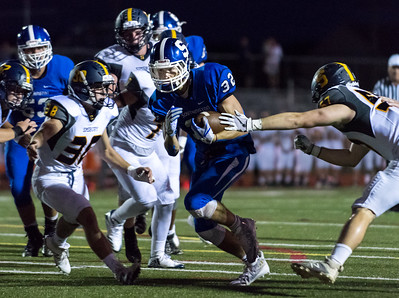 09/15/17  Wesley Bunnell | Staff  Southington vs Simsbury on Friday evening at Southing High School. Running back Ian Agnew (32) for a touchdown.