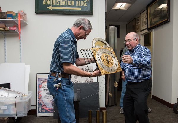 Wesley Bunnell   Staff The New Britain Industrial Museum moved the last of its collection to its new location on West Main St. in September 2017. Volunteer at American Clock and Watch Museum Bruce Thorin, L, holds the movement from a grandfather clock ready to be moved along with help from fellow museum volunteer Mel Brown.