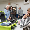 11/7/17  Wesley Bunnell | Staff<br /> <br /> Genevieve Wantek, L, is check in by Official Checkers Beverly Dube and Ron Field using the new Poll Pad verification system at Slade Middle School on Tuesday morning.