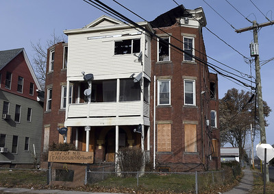 12/2/2017 Mike Orazzi | Staff A burned home on West Street in New Britain Saturday.