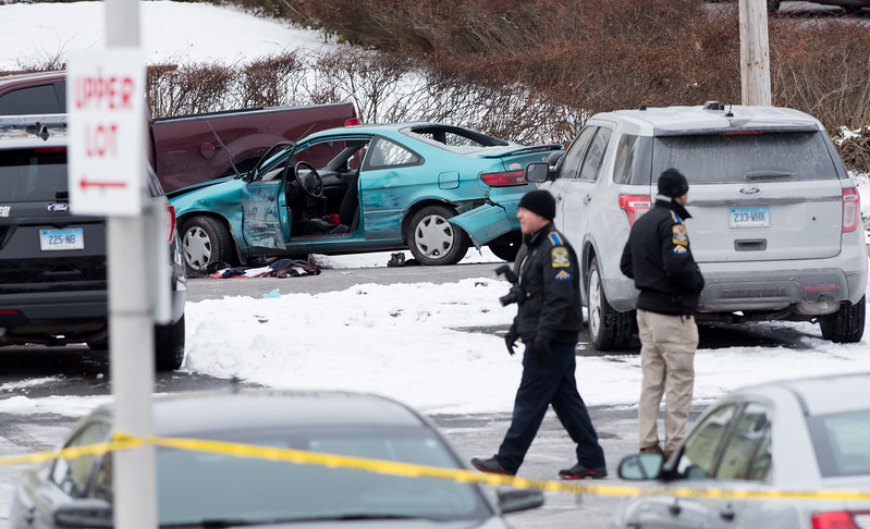 12/15/17  Wesley Bunnell | Staff<br /> <br /> State and New Britain Police on Friday morning at the intersection of Chapman St and Chapman Ct where an officer involved shooting occurred on Thursday evening involving three suspects in a green Toyota.  State Police collect evidence around the scene.