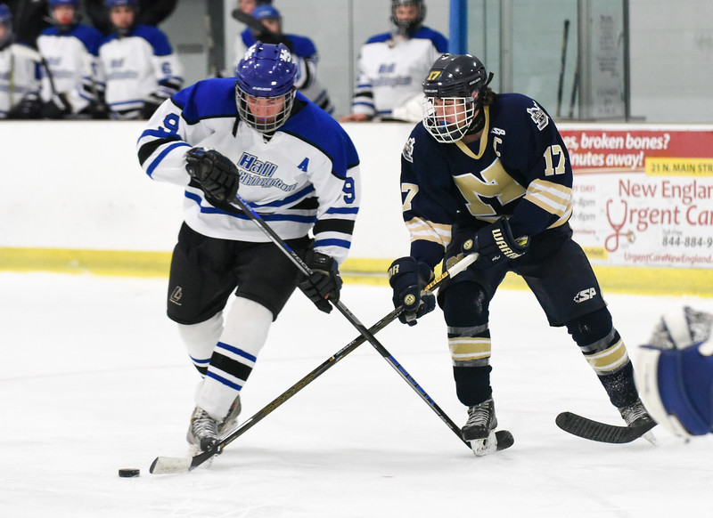 030617  Wesley Bunnell | Staff<br /> <br /> Newington-Berlin Hockey at Hall-Southington in a Division III first round game played at Veterans Memorial Skating Rink in West Hartford. Andrew Booth (9) for Hall-Southington and Alexander Borselle (17) for Newington-Berlin.