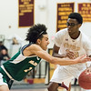01/15/18  Wesley Bunnell | Staff<br /> <br /> New Britain High School boys basketball was defeated 53-52 by New London on Monday evening. Shamah Charles (33) is able to keep possession from a diving New London defender.