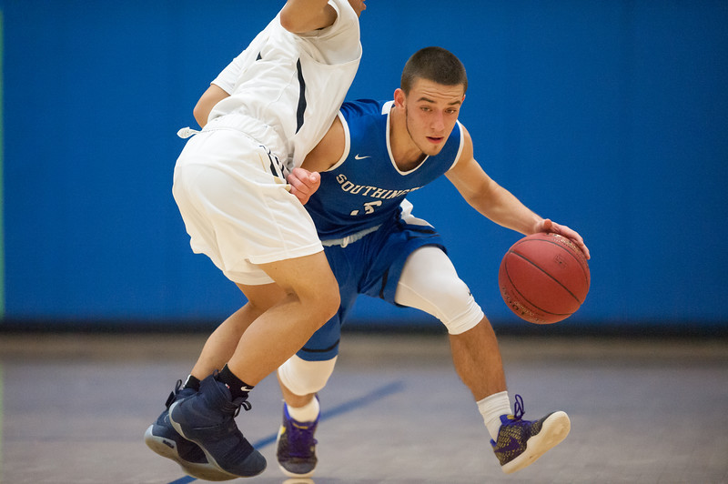 01/16/18  Wesley Bunnell | Staff<br /> <br /> Newington High boys basketball was defeated at home by Soutington on Tuesday evening 52-44. Colin Burdette (3).