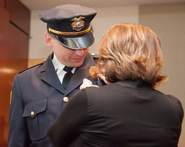 02/15/18  Wesley Bunnell | Staff  The New Britain Police Department promoted three of its own including the first female Captain in its history.  Adam Rembisz who was promoted to lieutenant has his badge pinned on his uniform by his wife.