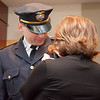 02/15/18  Wesley Bunnell | Staff<br /> <br /> The New Britain Police Department promoted three of its own including the first female Captain in its history.  Adam Rembisz who was promoted to lieutenant has his badge pinned on his uniform by his wife.