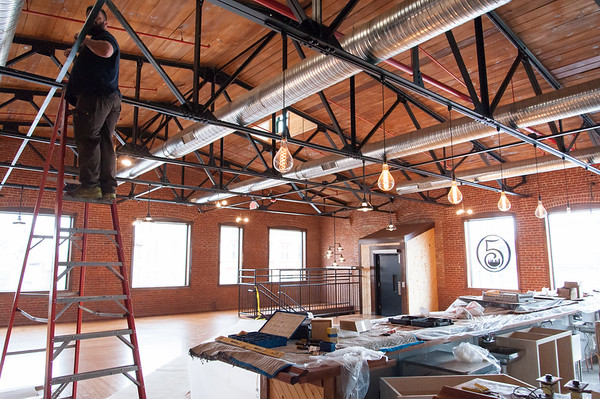 02/09/18  Wesley Bunnell | Staff  Work continues on Friday afternoon at Five Churches Brewing at 193 Arch St in New Britain in anticipation of its grand opening that is yet to be determined. The front of the facility is shown with old style Edison style bulbs hanging above the bar.