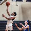 01/26/18  Wesley Bunnell   Staff<br /> <br /> E.C. Goodwin boys basketball vs Ellis Tech on Friday evening at E.C. Goodwin High School. Luis Aguiar (24) with a lay up.