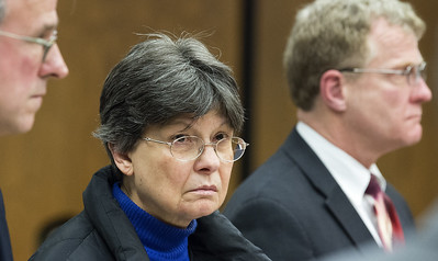 BRISTOL, CT - 02.13.2018 - BRISTOL ARRAIGNMENT - Linda L. Kosuda-Bigazzi, 70, accused of murdering her husband Pierluigi Bigazzi, is arraigned in Bristol Superior Court on Tuesday. State police are investigating whether University of Connecticut medical school professor Dr. Pierluigi Bigazzi, whose wife faces a murder charge after his body was found in his Burlington home last week, may have been dead for several months. At left is attorney Pat Tomasiewicz and at right is attorney Brian Karpe. Kosuda-Bigazzi is under house arrest and her case will be transferred to New Britain where she will appear on March 20. PATRICK RAYCRAFT | praycraft@courant.com