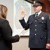 02/15/18  Wesley Bunnell | Staff<br /> <br /> The New Britain Police Department promoted three of its own including the first female Captain in its history.  Adam Rembisz who was promoted to lieutenant is sworn in by Mayor Erin Stewart.