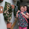 120716 Wesley Bunnell | Staff<br /> <br /> The 8th Annual Festival of Wreaths and Wine Tasting Charity Event was sponsored by Cassena Care at New Britain and the Rotary Club of Kensington-Berlin on Dec 7. CNA Elaine McCue, left, with R.N. Supervisor Karolina Wierzbicka stopped for a moment as the entered their raffle tickets to win Christmas Wreaths.
