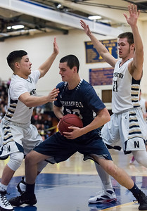 012017  Wesley Bunnell | Staff  Newington boys basketball vs Wethersfield on Friday evening at Newington High School. Cooper Johnson (5) , left, and Matt McKinnon (21) guard a Wethersfield player.
