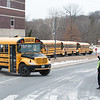 03/21/18  Wesley Bunnell | Staff<br /> <br /> New Britain High School Resource Officer Jerzy Chmura directs the line of buses leaving the school on early dismissal due to the nor'easter expected later in the day on Wednesday.