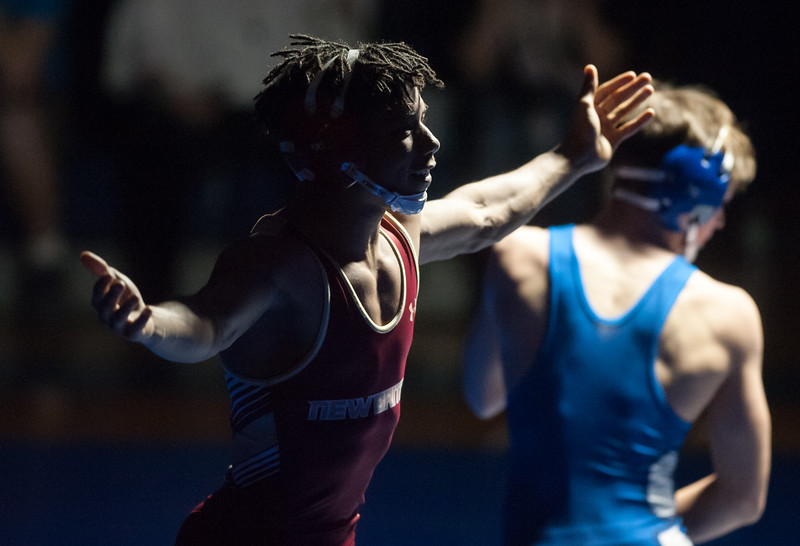 02/08/18  Wesley Bunnell | Staff<br /> <br /> New Britain's Elijah Wattson motions to the New Britain side after his victory over Southington's Dawson Welch in the 132lb class contest at Southington High School on Thursday night.