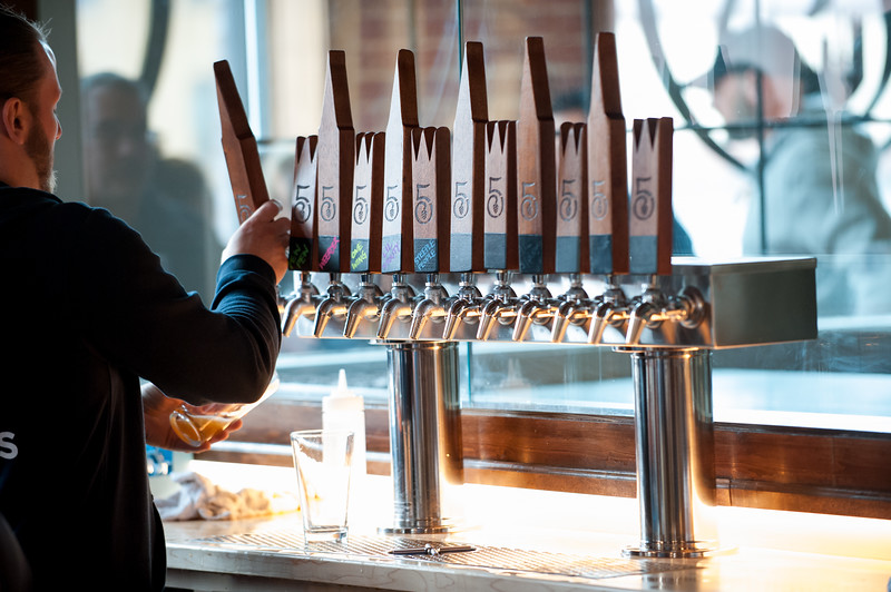 03/30/18  Wesley Bunnell | Staff  5 Churches Brewing held their ribbon cutting with city officials on Friday at noon to a crowd of customers lined down the sidewalk. Brandon Jacobs pours a beer for a customer.