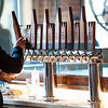 03/30/18  Wesley Bunnell | Staff<br /> <br /> 5 Churches Brewing held their ribbon cutting with city officials on Friday at noon to a crowd of customers lined down the sidewalk. Brandon Jacobs pours a beer for a customer.