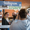03/30/18  Wesley Bunnell | Staff<br /> <br /> 5 Churches Brewing held their ribbon cutting with city officials on Friday at noon to a crowd of customers lined down the sidewalk.  Kirsten Ringsted poses for an Instagram photos with Jason Fontain as its taken by 5 Church's media consultant Melissa Jones.