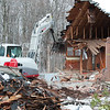 04/02/18  Wesley Bunnell | Staff<br /> <br /> Demolition of a house adjacent to Kensington Congregational Church started on Monday which is the first step in an expansion to the church property. The excavator tears into the main house area with remnants of the garage piled in front.
