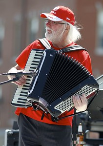 Kevin Bartram | Staff Gene Kozlowski performs with the band Gypsy Dreams at the second annual Little Poland Festival on Broad Street in New Britain on Sunday.