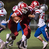 10/27/17  Wesley Bunnell | Staff<br /> <br /> Tolland @ Berlin High School football on Friday evening at Sage Park. Tyler Tralli (59) blocks for captain James Mazzarella (2).