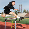 02/26/18  Wesley Bunnell | Staff<br /> <br /> NBHS Senior Carlos Villarini runs the hurdles as the rest of his indoor track team spent Monday afternoon holding outdoor practice at Veterans' Stadium taking advantage of the mild weather.