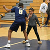 060617 Wesley Bunnell | Staff<br /> <br /> Newington boys volleyball defeated Joel Barlow at Kennedy High School in Waterbury in a semi final game to advance to the championship game to be played on June 8. Louis Egbuna (8) celebrates after the win with a fan.