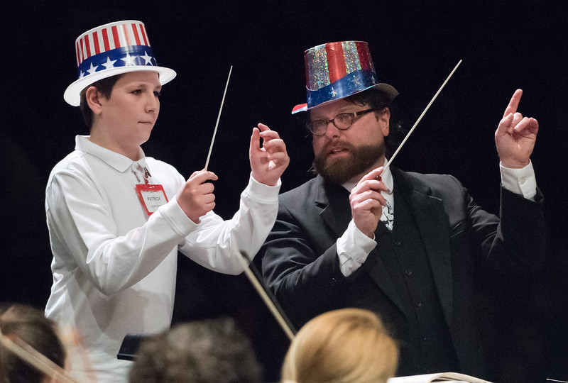 04/04/18  Wesley Bunnell | Staff  The New Britain Symphony Orchestra performed for over 800 New Britain 5th grade students citywide in the annual Young People's Concert on Wednesday morning at Welte Halle at CCSU. Vance School student Patrick Clemens Dolan, standing with NBSO Maestro Ertan Seyyar Sener, was chosen as guest conductor to lead the orchestra during a performance of Stars and Stripes Forever.