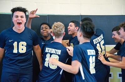 05/23/18  Wesley Bunnell | Staff  Newington volleyball defeated East Hartford in a semi final CCC Tournament game at East Hartford on Wednesday evening. Players celebrate at the end of the game Julian Ortiz (16), Louis Egbuna (2) makes the L sign for his name and Leonel Caceres (13).