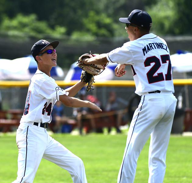 8/8/2018 Mike Orazzi   Staff Mid Island New York's Gregory Bruno (24) and Steven Martinez (27) celebrate a win over Middletown New Jersey at Breen Field in Bristol.