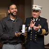 "022217  Wesley Bunnell | Staff<br /> <br /> Juan ""Gaby"" Busanet received awards and recognition before the New Britain Common Council meeting on Feb 22. Busanet helped to rescue several residents of a burning building by climbing a ladder to the third floor of a burning building on West St. during a heavy snowstorm on Feb 9. Gaby Busanet receives a Citizens Service Award from New Britain Fire Chief Ronalter."