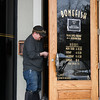 021617  Wesley Bunnell | Staff<br /> <br /> A worker replaces the locks to the entrance to the Bonefish Grill in Newington on Thursday Feb. 16 after the restaurant permanently closed.