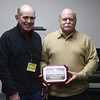 2/21/2017 Mike Orazzi | Staff<br /> Val Dumais presents Ed Roy of Walker Crane the Business Expansion Award from the Plainville Economic Development Agency on Tuesday afternoon.