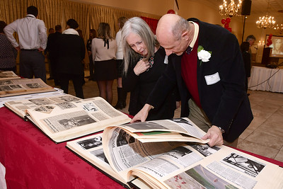 2/1/2017 Mike Orazzi | Staff Lyn and Joe Crispino flip through a scrap book of events during the Southington-Cheshire Community YMCA's 88th Annual Meeting held at the Aqua Turf Club Wednesday evening.