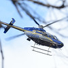 033017  Wesley Bunnell | Staff<br /> <br /> A CT State Police helicopter hovers overhead in the woods off of Loon Lake Rd in Plainville searching for missing hiker Arthur Williams who was last seen Saturday.