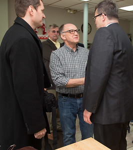 Walter Radziwillowicz, co-owner of Eurp Plate restuarant, greets Polish Ambassador Piotr Wilczek, right, and Darek Barcikowski, Honoray Consul, during their tour of local business on Broad Street in New Britain, April 1, 2017. (Photo by Christopher Zajac)