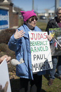 04.02.17 Christopher Burns | Special to the Herald Sunny Torres, of Harwinton, protests against former Trump campaign adviser Paul Manafort, a New Britain native, on Sunday, April 2.