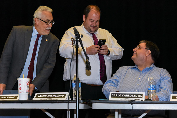 042517  Wesley Bunnell | Staff<br /> <br /> The New Britain Common Council held its annual public hearing at 7 p.m. Tuesday evening at Smalley Academy regarding Mayor Erin Stewart's proposed budget plan. After a quick meeting with little public participation Aldermen Daniel Salerno, Jamie Giantonio and Carlo Carlozzi Jr prepare to leave.