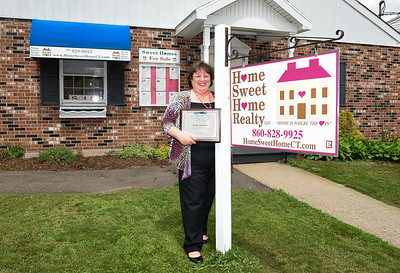 050217  Wesley Bunnell | Staff  Owner Elaine Pavasaris of Home Sweet Home Realty holds her award for best real estate in the town of Berlin.