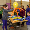 052517  Wesley Bunnell | Staff<br /> <br /> The Berlin High School Upbeat Club held their annual picnic at the Berlin Fair Grounds on a soggy Thursday May 25. Senior Cara Gileau makes an octopus balloon animal for six year old Tony Pietraoia.