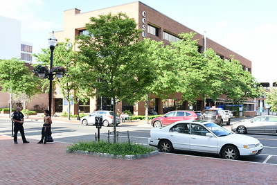 053117  Wesley Bunnell | Staff  New Britain police responding to reports of a person with a machete on Main St. Wednesday afternoon. No machete was found but one person was arrested for drug possession. Police talk with an occupant of the car involved in the incident who was eventually allowed to leave.