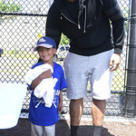 6/24/2017 Mike Orazzi | Staff Washington Redskins tight end Jordan Reed poses with young fan Brandon Santiago during the Tebucky Jones football camp held at Chesley Park in New Britain Satur ...