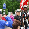 052917  Wesley Bunnell | Staff<br /> <br /> Plainville held their annual Memorial Day Parade on Monday morning followed by a memorial unveiling dedicated to Gold Star Families at Veterans Memorial Park. A veteran salutes during the ceremony with the Marine Honor Guard in the background.