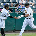 062217  Wesley Bunnell | Staff  New Britain Bees vs Sugarland Skeeters on Thursday evening. Craig Maddox (24) is congratulated by coach Daisuke Yoshida (11).