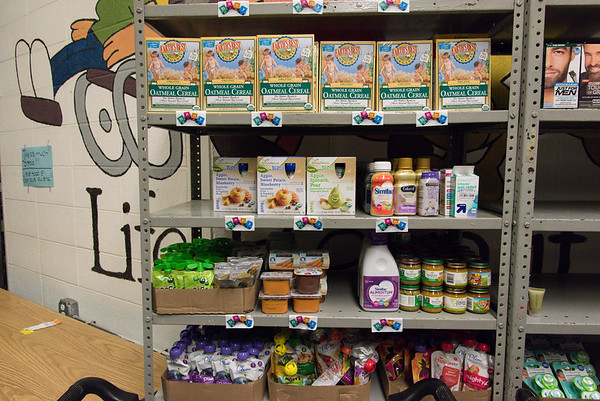 051917  Wesley Bunnell | Staff  Baby food and items on the shelves at the HRA Food Pantry in Osgood Heights Park on Friday afternoon.