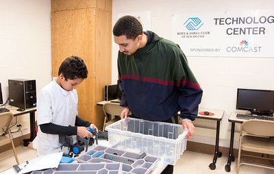 12/04/18  Wesley Bunnell | Staff  The Bristol Boys and Girls Club held robotics classes in collaboration with the New Britain Boys and Girls Clubs on Tuesday nights where Bristol employees taught students at the New Britain location. New Britain employee Gabe Yopp helps Keyrran Riddle with his project.