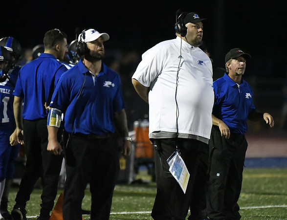 9/8/2017 Mike Orazzi | Staff Plainville High School Football Coach Tim Shea on opening night against Bloomfield.