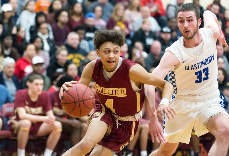 03/12/19  Wesley Bunnell   Staff  New Britain basketball defeated Glastonbury 56-53 in state semifinal game to advance to the championship game to be played this Saturday or Sunday at the Mohegan Sun Casino.  Maurice Turner (4) drives baseline and scores to give New Britain a 46-43 lead in the 4th quarter.