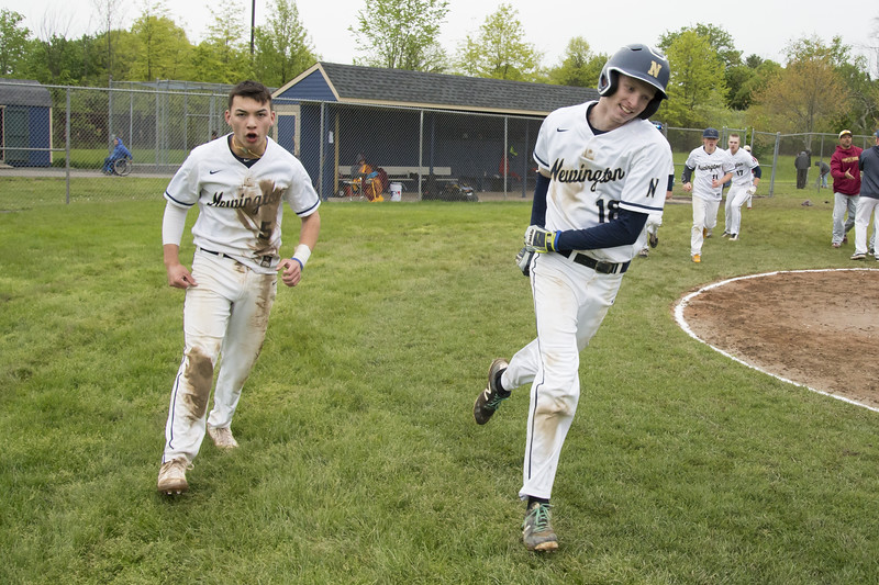 05/14/19  Wesley Bunnell   Staff  Newington baseball defeated New Britain 4-3 in a walk off on Tuesday afternoon at Newington High School. Newington's Gunnar Johnson (5) and Jack Kelley (18) after shaking hands with New Britain.